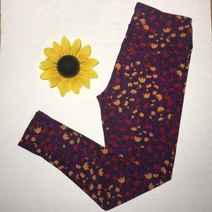 LULAROE Purple with Yellow/Red flowers Leggings
